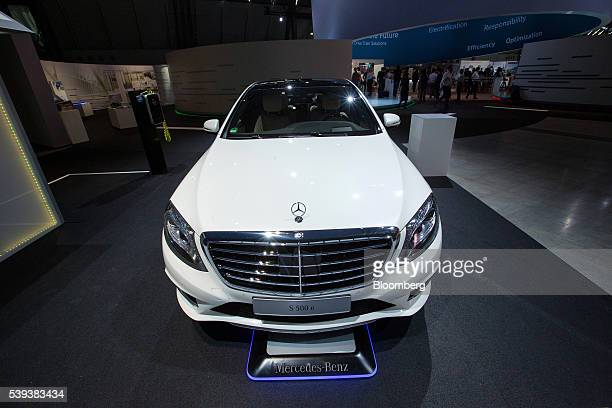 A MercedesBenz S500 hydrid automobile sits parked over a wireless electrical charging station during Daimler AG's TecDay Road to the Future event in...
