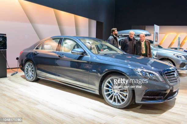 MercedesBenz S500e Plugin Hybrid luxury limousine sedan rear view with an electric vehicle charging station on display at Brussels Expo on January 13...