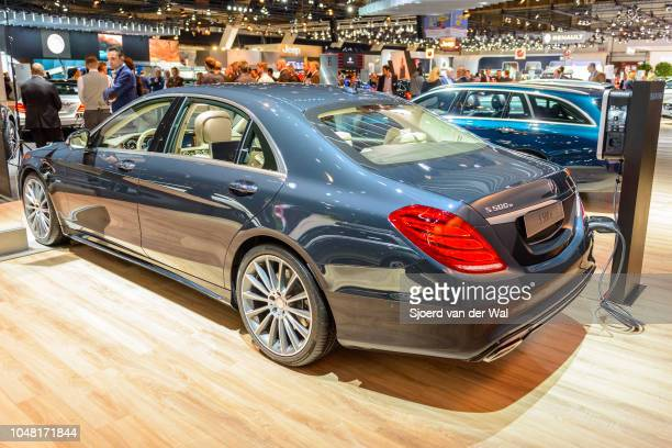 Mercedes-Benz S500e Plug-in Hybrid luxury limousine sedan rear view with an electric vehicle charging station on display at Brussels Expo on January...