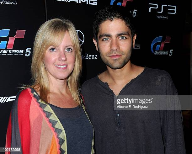 MercedesBenz's Lisa Holladay and actor Adrian Grenier arrive as MercedesBenz celebrates PlayStation 3 Gran Turismo 5 featuring the SLS AMG at SLS...