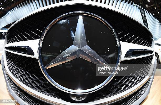 MercedezBenz logo on a GLE coupe is pictured at The North American International Auto Show in Detroit Michigan on January 12 2015 The Detroit auto...