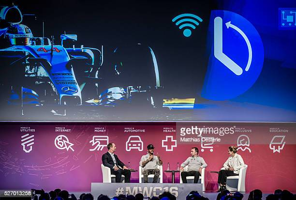 ABERLE Merceds AMG Petronas F1 pilot LEWIS HAMILTON PADDY LOWE and NICKI SHIELDS talk during a keynote at the second of the annual Mobile World...