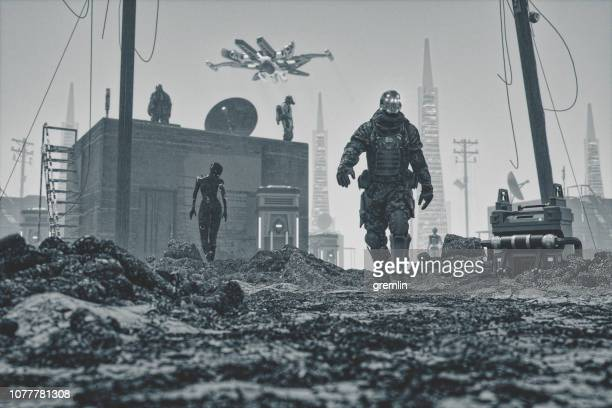 mercenary cyborg walking in futuristic apocalypse city ruins - android stock pictures, royalty-free photos & images