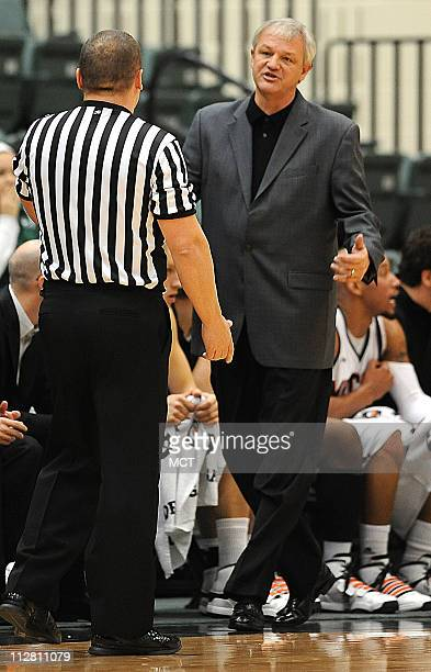 Mercer head coach Bob Hoffman right has a word with an official during a first half time out during a Legends Classic subregional game against...