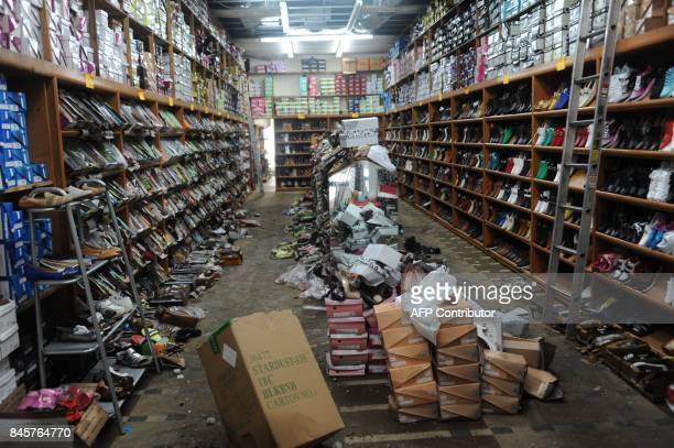 Merchandise at JL Shoes Sneakers is seen destroyed because of water damage after their roof caved in the aftermath of Hurricane Irma in Miami Florida...