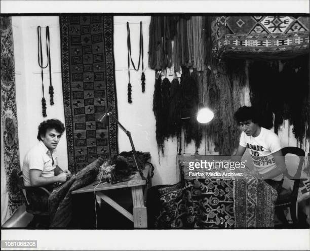 Merchandise at Nomadic Rug Traders Cleveland St Surry HillsRug restorers Ahmet Solak and Ali Boge working upstairs January 19 1984