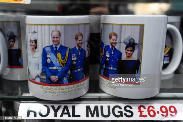 Merchandise featuring Prince Harry Duke of Sussex and Meghan Duchess of Sussex and Prince William and Catherine Duchess of Sussex is seen on sale on...