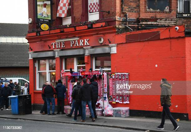 Merchandise for sale outside The Park pub prior to the UEFA Champions League Round of 16 First Leg match between Liverpool and FC Bayern Muenchen at...