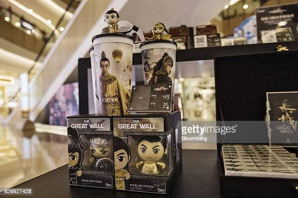 Merchandise from the movie 'The Great Wall' is displayed for sale at an Mtimecom Inc kiosk at a shopping mall in Beijing China on Thursday Nov 24...