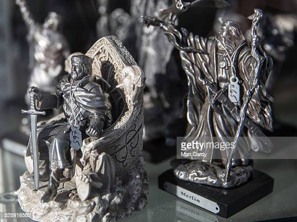Merchandise inspired by the legend of King Arthur is displayed in the window of a shop in Tintagel on April 27 2016 in Cornwall EnglandThe English...
