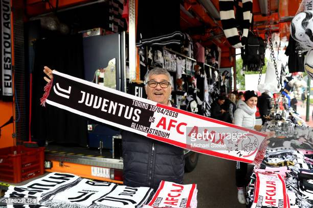 Merchandise is sold outside the stadium ahead of the UEFA Champions League Quarter Final second leg match between Juventus and Ajax at Allianz...