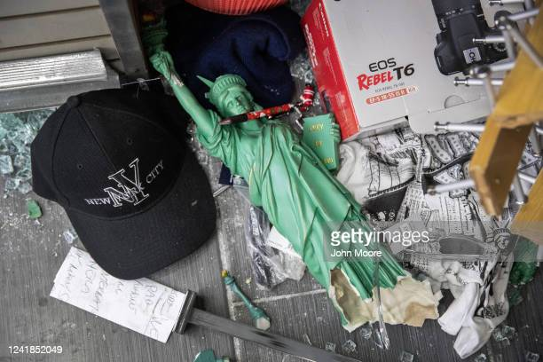 Merchandise lies scattered in a looted souvenir and electronics shop near Times Square after a night of protests and vandalism over the death of...