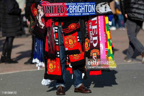 A merchandise seller displays a variety of scarves for sale before the Premier League match between Manchester United and Brighton Hove Albion at Old...