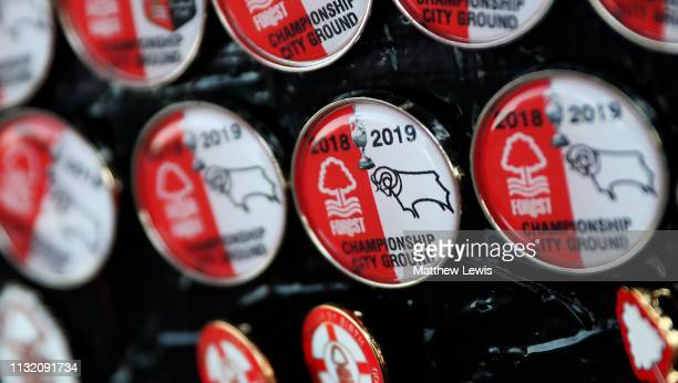 A merchandise seller sells badges for tonights match ahead of the Sky Bet Championship match between Nottingham Fotrest and Derby County at City...