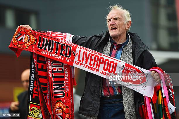 A merchandise seller sells scarves prior to the Barclays Premier League match between Manchester United and Liverpool at Old Trafford on September 12...