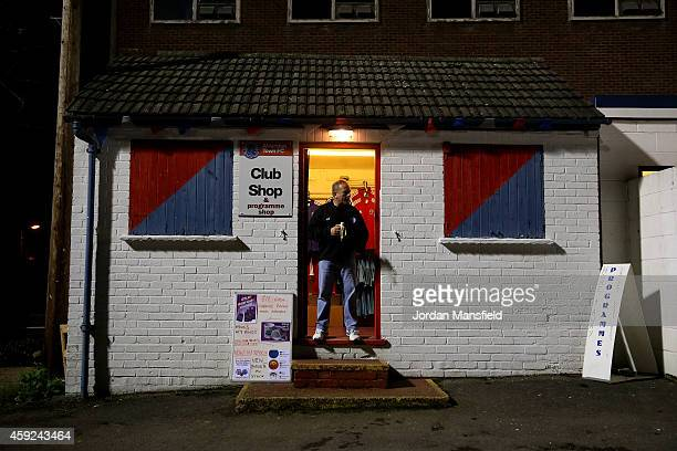 A merchandise seller stands outside the club shop ahead of the FA Cup First Round Replay match between Aldershot Town and Portsmouth at The...