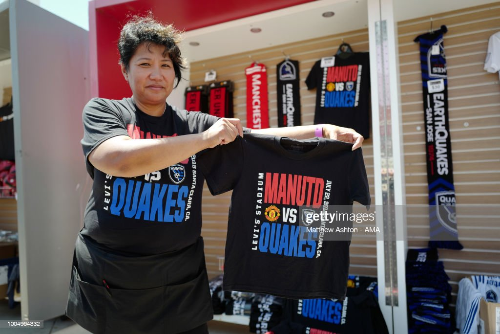 Merchandise sellers hold up commemorative T-shirts priori to the Pre-Season match between Manchester United v San Jose Earthquakes at Levi's Stadium on July 22, 2018 in Santa Clara, California.