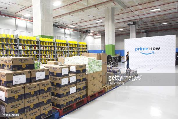 Merchandise sits on shelves and pallets at Amazoncom Inc's Amazon Prime Now fulfillment center in Singapore on Thursday July 27 2017 Amazon is...