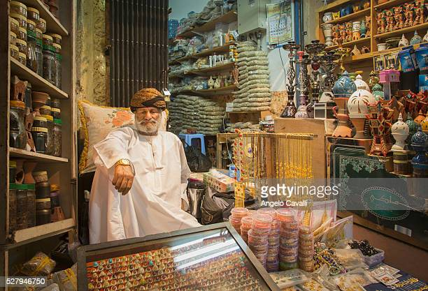 merchant in his shop in muscat souk, oman - muscat governorate stock pictures, royalty-free photos & images