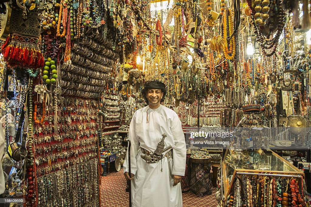 Merchant in his shop in the Souk of Muscat. : Stock Photo