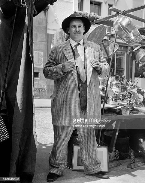 A merchant in Portobello Road Market London 1962