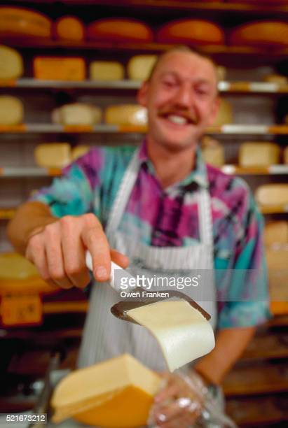 Merchant Offering Cheese Samples