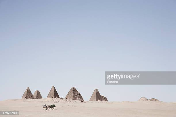 merchant on a camel at the meroe pyramids - meroe stock pictures, royalty-free photos & images