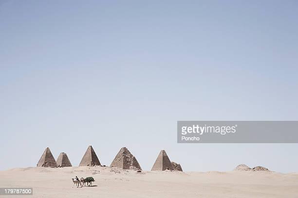 merchant on a camel at the Meroe pyramids
