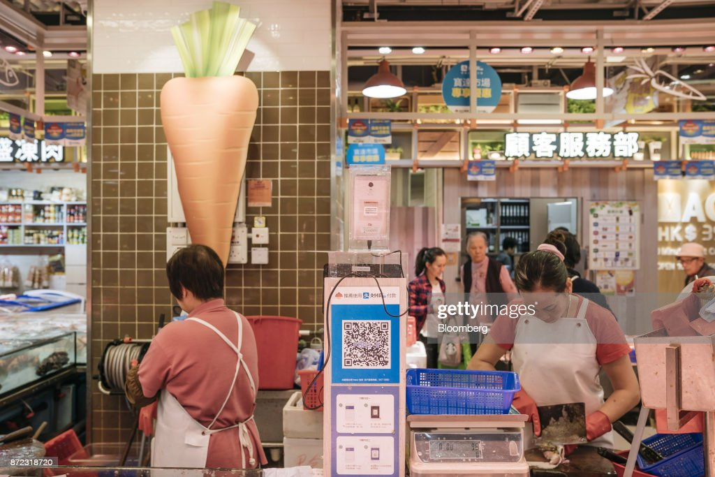 A merchant quick response (QR) code for Ant Financial Services Group's Alipay, an affiliate of Alibaba Group Holding Ltd., is displayed at a fish stall inside MC Box Po Tat Market in Hong Kong, China, on Tuesday, Nov. 7, 2017. Ant Financial, which has been valued as high as $75 billion, is the world's most valuable closely held fintech company. Photographer: Anthony Kwan/Bloomberg via Getty Images
