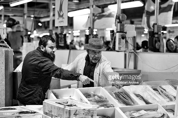 Merchant Roger Barton photographed with a customer at Billingsgate Fish Market near Canary Wharf in London's Docklands Mr Barton who is often called...