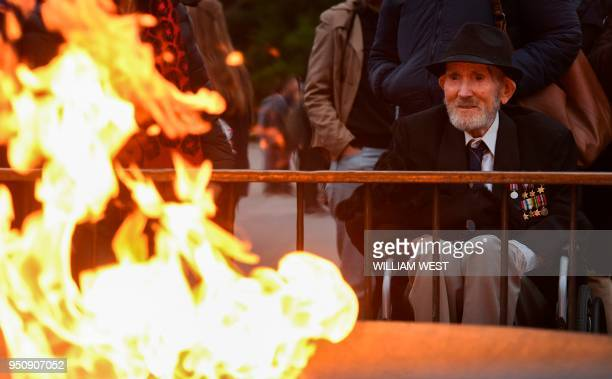 Merchant seaman Guy Griffiths pays his respects at the eternal flame during the dawn service at Melbourne's Shrine of Remembrance on Anzac Day on...