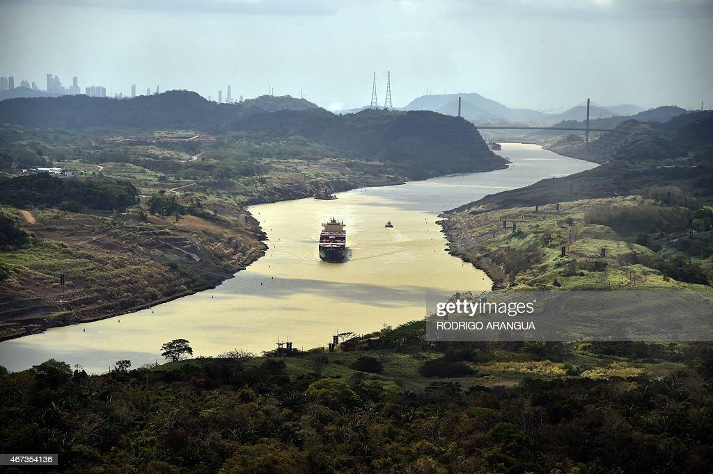A merchant ship sails along the Panama Canal, on March 23, 2015. AFP PHOTO/ Rodrigo ARANGUA