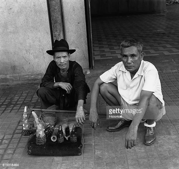 Merchants sell polished rhinoceros horns on a street in Saigon