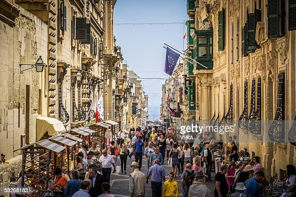 merchants street, valletta, malta - valletta stock pictures, royalty-free photos & images