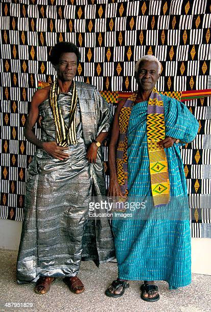 Merchants wearing traditional kente cloth in the village of Bonwire in the Ashanti Region of Ghana West Africa