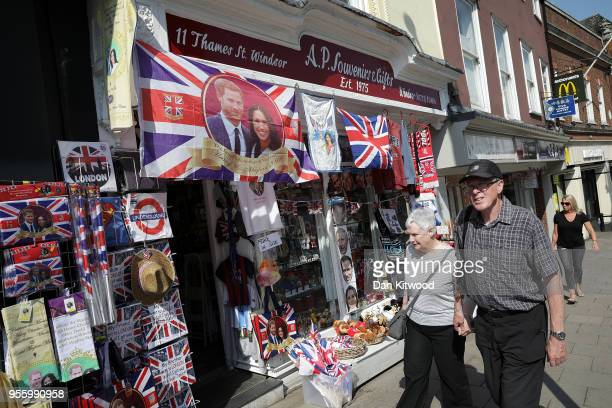 Merchendise is sold in a shop outside Windsor Castle as the town prepares for the wedding of Prince Harry and his fiance US actress Meghan Markle on...