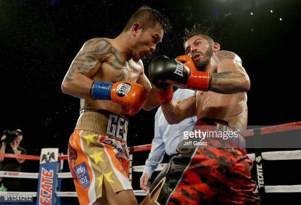 Mercito Gesta lands a left hand to the head of Jorge Linares of Venezuela during their bout at The Forum on January 27 2018 in Inglewood California