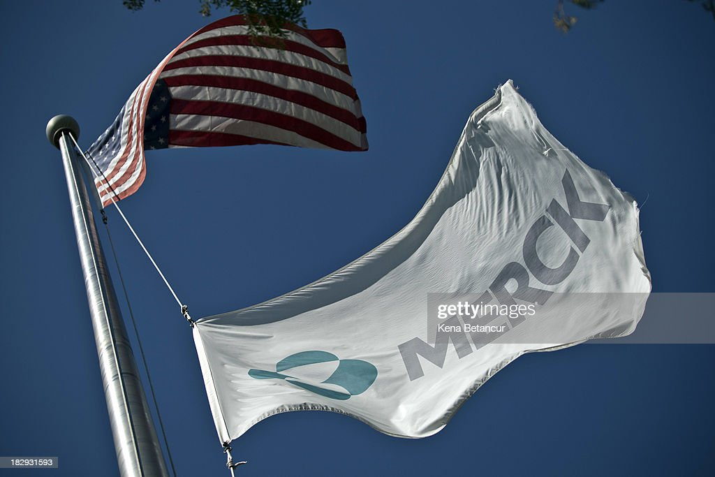 A Merck flag flies in front of the company's building on October 2, 2013 in Summit, New Jersey. The pharmaceutical company Merck & Co. announced today that it would cut 8,500 jobs and consolidate its real estate in Kenilworth, New Jersey instead of moving its headquarters to Summit as previously planned.
