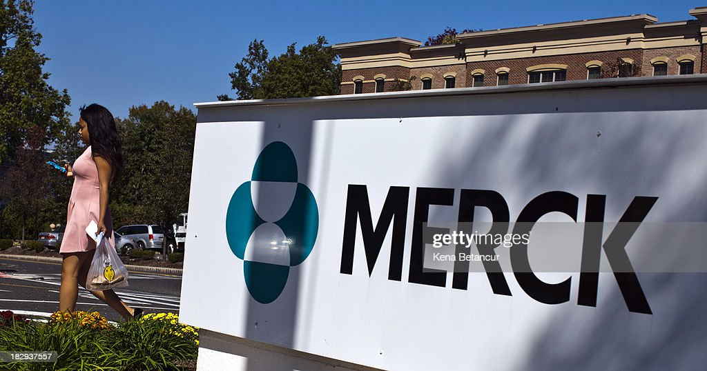 A Merck sign stands in front of the company's building on October 2, 2013 in Summit, New Jersey. The pharmaceutical company Merck & Co. announced today that it would cut 8,500 jobs and consolidate its real estate in Kenilworth, New Jersey instead of moving its headquarters to Summit as previously planned.