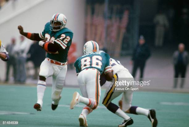 Mercury Morris of the Miami Dolphins runs with the ball during Super Bowl VIII against the Minnesota Vikings at Rice Stadium on January 13 1974 in...
