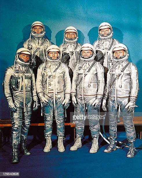 US Mercury program astronauts in their space suits pose for a family picture in 1962 1rst row from left to right Walter M Wally Schirra Donald K Deke...