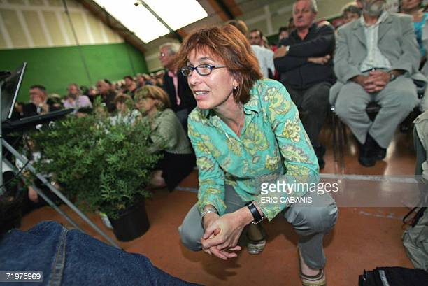 Potential Socialist Party presidential candidate Segolene Royal's press attache Agnes Longueville listens to a speech 22 September 2006 in Mercus...