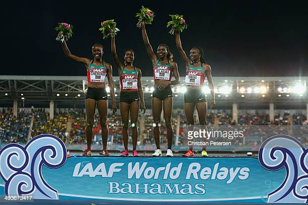 Mercy Cherono Faith Chepngetich Kipyegon Irene Jelagat and Hellen Onsando Obiri of Kenya celebrate on the podium after setting a new world record of...