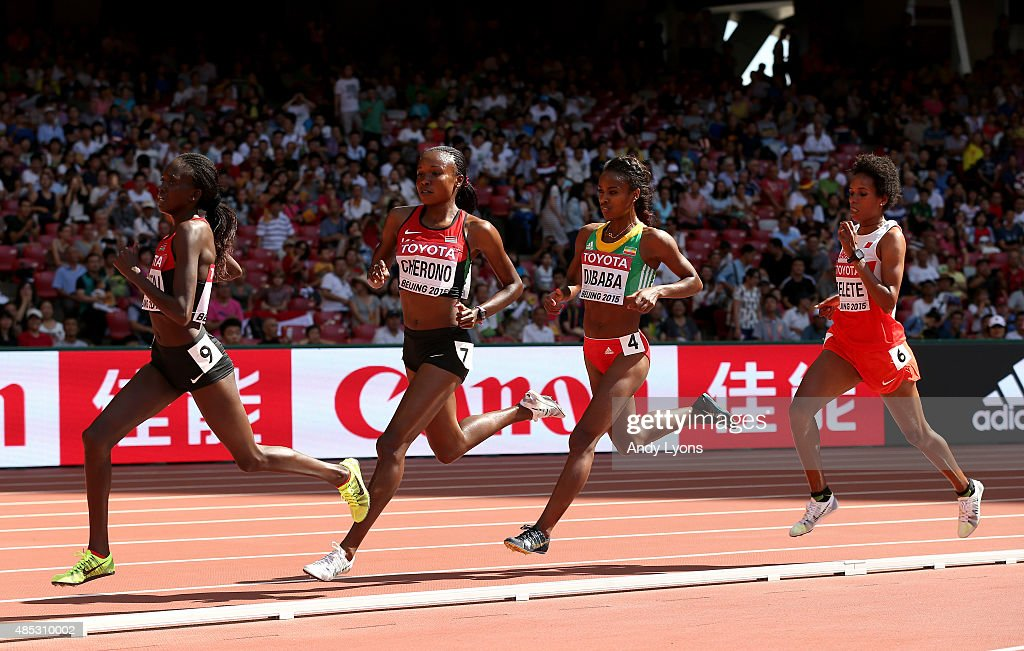 Mercy Cherono of Kenya (2nd L) and Genzebe Dibaba of Ethiopia (2nd R) compete in the Women's 5000 metres heats during day six of the 15th IAAF World Athletics Championships Beijing 2015 at Beijing National Stadium on August 27, 2015 in Beijing, China.