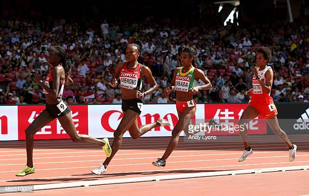Mercy Cherono of Kenya and Genzebe Dibaba of Ethiopia compete in the Women's 5000 metres heats during day six of the 15th IAAF World Athletics...