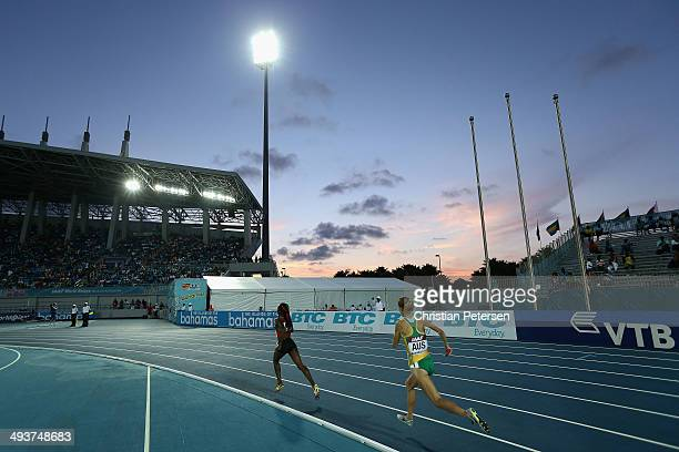 Mercy Cherono of Kenya and Zoe Buckman of Australia compete in the Women's 4x1500 metres relay final during day one of the IAAF World Relays at the...