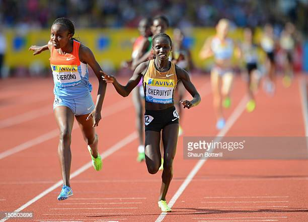 Mercy Cherono of Kenya beats teammate Vivian Jepkemoi Cheruiyot in the 3000m during the Samsung Diamond League 2012 Aviva Birmingham Grand Prix at...