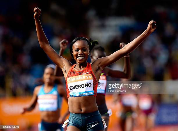 Mercy Cherono of Kenya celebrates winning the Women's 2 mile during the Diamond League at Alexander Stadium on August 24 2014 in Birmingham England