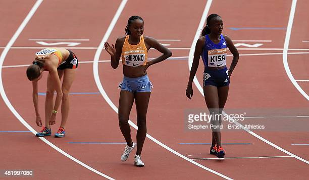Mercy Cherono of Kenya celebrates winning the womens 5000m alongside second place Molly Huddle of USA and third place Janet Kisa of Kenya during day...
