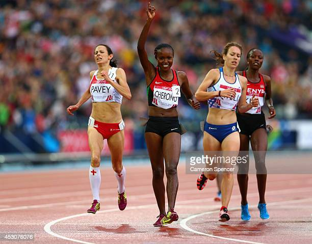 Mercy Cherono of Kenya crosses the line to win gold ahead of bronze Jo Pavey of England in the Women's 5000 metres final at Hampden Park during day...